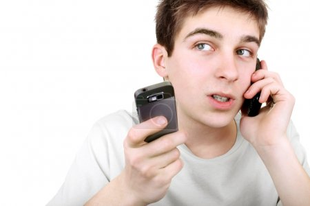 Busy teenager with two phones
