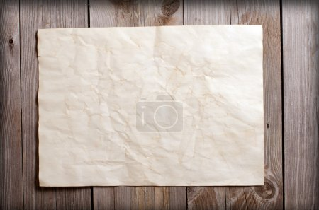 Old paper on a wooden surface