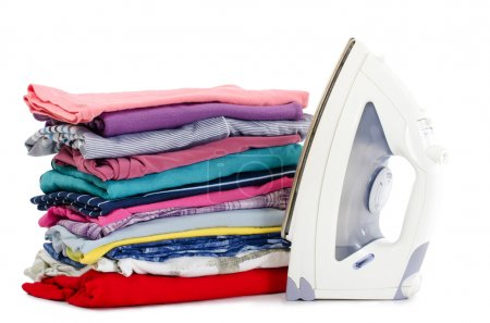 Photo for Heap of pure clothes with an iron - Royalty Free Image