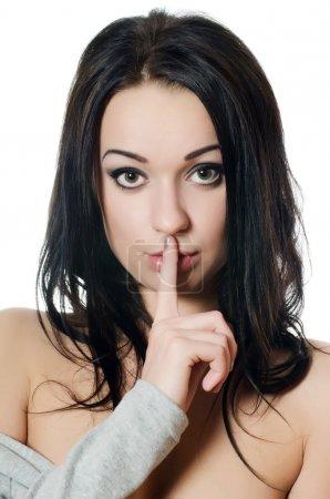 Photo pour Secret - jeune fille avec son doigt sur la bouche - image libre de droit