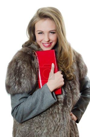 The beautiful girl with red handbag