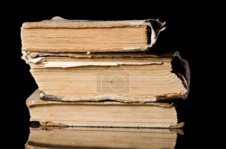 Photo for Pile of old books on black background - Royalty Free Image