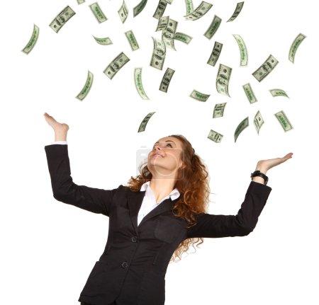 Photo pour Le portrait de la jeune femme d'affaires attrayante qui attrape dollars mains sur le fond blanc isolé - image libre de droit