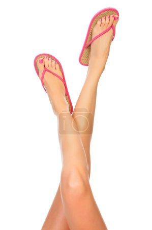 Female legs with flip-flops
