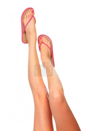 Female legs with flip-flops