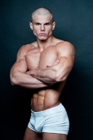 Photo for Muscled male model posing in studio - Royalty Free Image