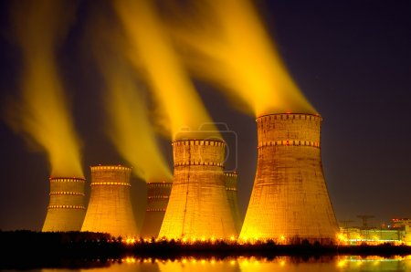 The cooling towers at night of the nuclear power generation plan