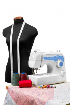 Photo for Professional dressmaker equipment: mannequin, sewing machine, patterns of clothing (template plan), spool of thread, isolated - Royalty Free Image