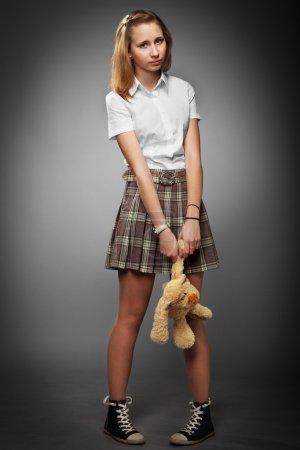 Teenager girl with teddy bear
