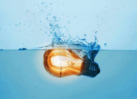 Glowing light bulb in water