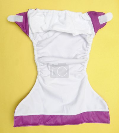 Open Eco Friendly Cloth Diaper on Yellow Background
