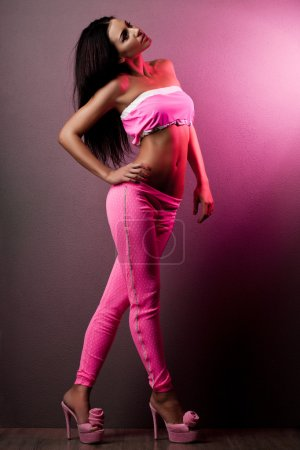 Elegant fashionable woman in pink clothes