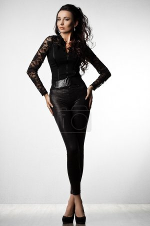 Beautiful fashionable woman in black clothes