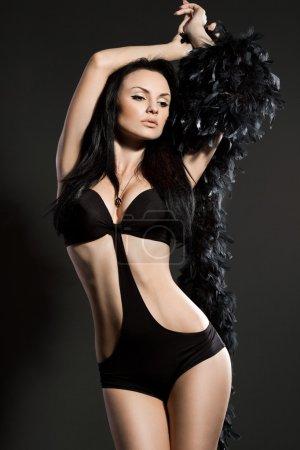 Elegant fashionable woman on black background