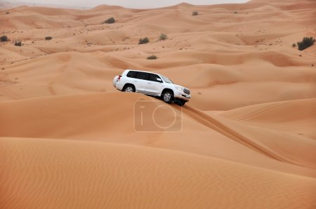 Jeep safari in the sand dunes of the arabian desert