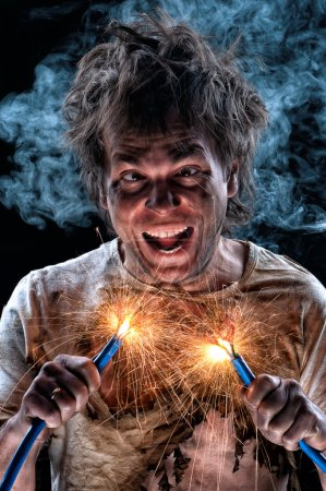 Photo for Portrait of crazy electrician over black background - Royalty Free Image