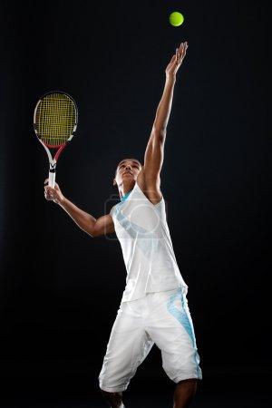 Serving a tennis ball