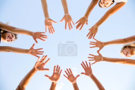 Photo for Hands of young stretching to the center - Royalty Free Image
