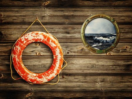 Photo for Lifebuoy and porthole with sea view - Royalty Free Image