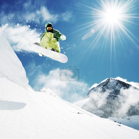 Photo for Snowboarder at jump inhigh mountains at sunny day. - Royalty Free Image