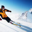 Skier in mountains, prepared piste and sunny day...