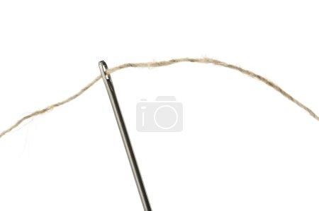 Needle and thread closeup