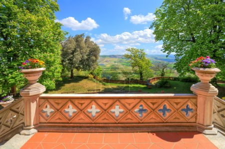 Photo for View on small yard and hills from stone terrace of Novello castle in Piedmont, Northern Italy. - Royalty Free Image