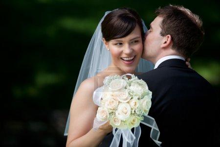 Groom Kissing Bride on Ear