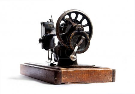 Retro sewing machine over white...