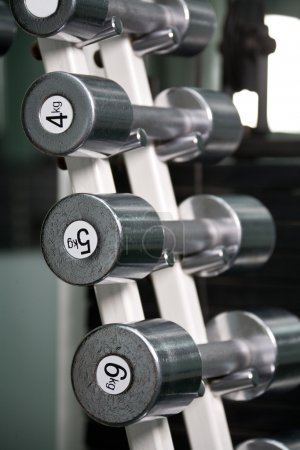 Photo for Chrome dumbbells in a row on stand - Royalty Free Image