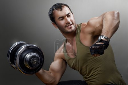 Photo for Powerful muscular man lifting weights - Royalty Free Image