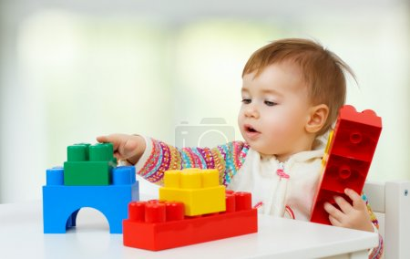 Photo for Little child playing with with toys - Royalty Free Image