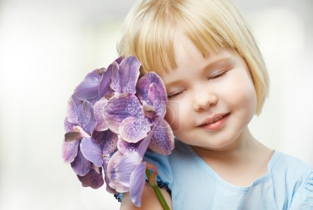 Photo for Beauty flower girl on the blurry background - Royalty Free Image