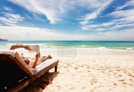 Photo for Relaxing and reading book at the beach . Thailand - Royalty Free Image