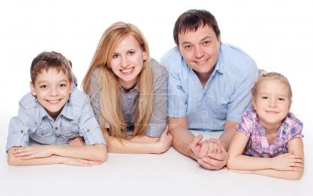 Photo for Happy family with child isolated on white background. Parents with girl and boy studio shot - Royalty Free Image
