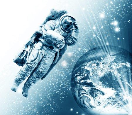 Cosmonaut flying to the earth