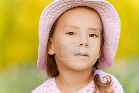 Little girl in hat close up