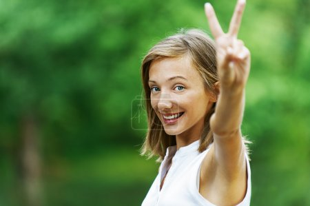 Woman showing gesture that everything is Victory
