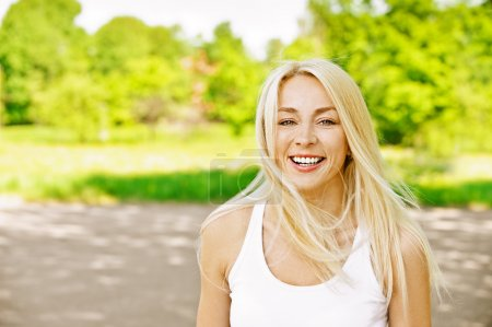 Young woman laughs merrily