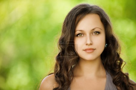 Photo for Closeup portrait young beautiful woman at summer green park - Royalty Free Image