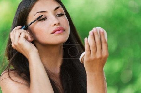 Portrait beautiful woman bare paints eyelashes