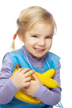 Little smiling girl with bananas
