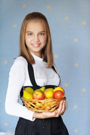 Girl-teenager holding basket with apples