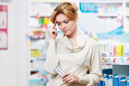 Photo for The pharmacist at the pharmacy of pills - Royalty Free Image