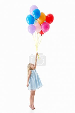 Photo for Little girl with balloons on a white background - Royalty Free Image