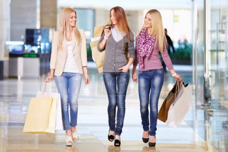 Photo for Beautiful girl with shopping bags in shop - Royalty Free Image