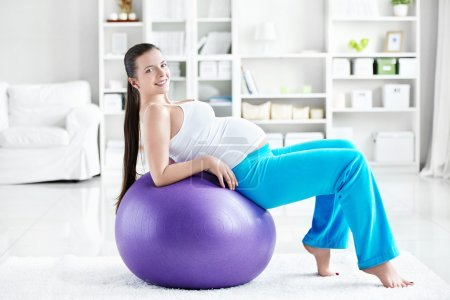 Photo for A pregnant young woman is doing on fitball - Royalty Free Image
