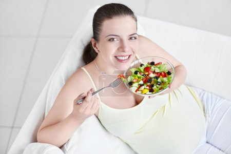 Photo for Young pregnant woman eating salad - Royalty Free Image