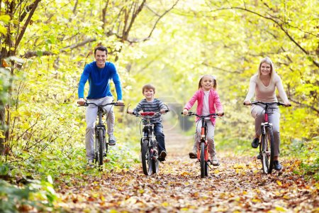 Photo for The family in the park on bicycles - Royalty Free Image