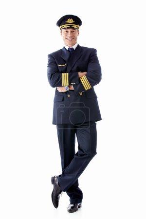 Photo pour Un homme habillé en pilote sur fond blanc - image libre de droit